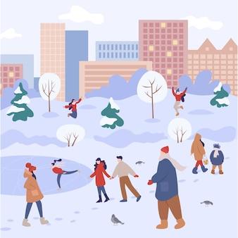 人々は冬に屋外で時間を過ごします。冬のアクティビティを行う暖かい服を着た人々。家族で街の冬のアクティビティ。