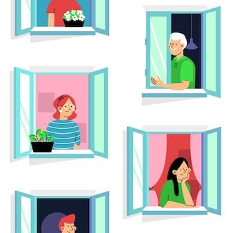 Le persone trascorrono del tempo alle loro finestre