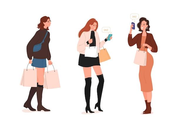 Persone in piedi e in possesso di borse della spesa