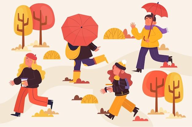 가을 공원에서 산책하는 사람들