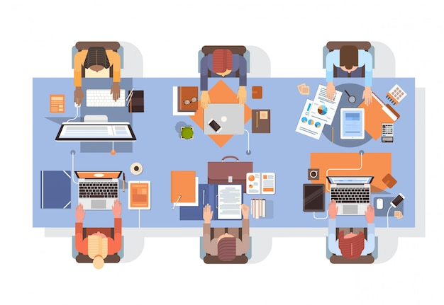 People using computers businesspeople workplace desk top angle view teamwork