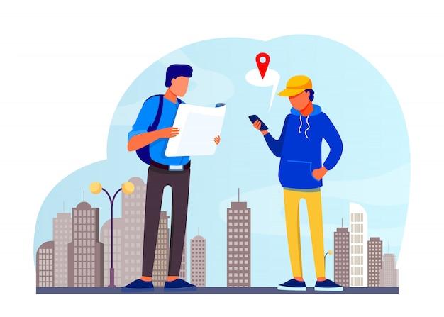 Люди, использующие бумажную карту и приложение для определения местоположения на мобильном телефоне