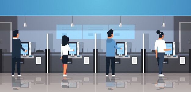 People using self service machine payment terminal