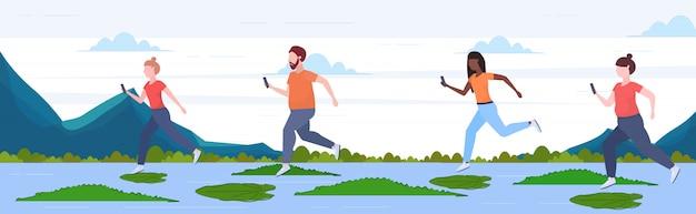 악어 위험 및 위험 결정 디지털 중독 개념 전체 길이 가로 평면 강에 로터스 잎 위로 점프하는 스마트 폰을 사용하는 사람들