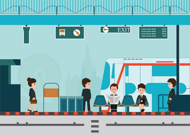 人々は鉄道駅の列車で列車を待つ。