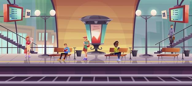 실내 기차역 플랫폼에서 기차를 기다리는 사람들