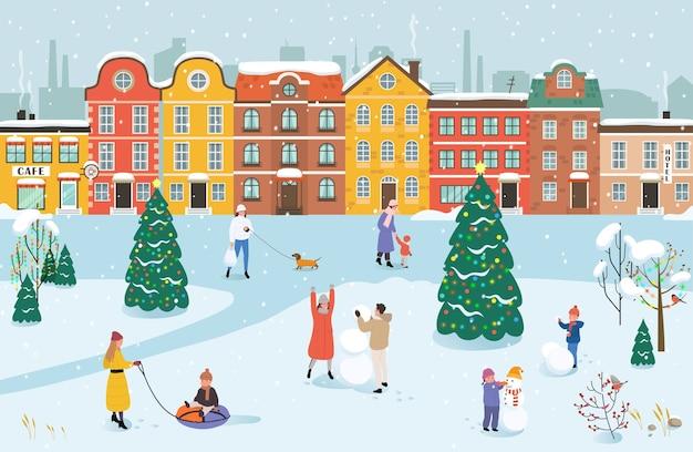 Люди гуляют по парку зимой. мужчины, женщины и дети занимаются зимними видами спорта.