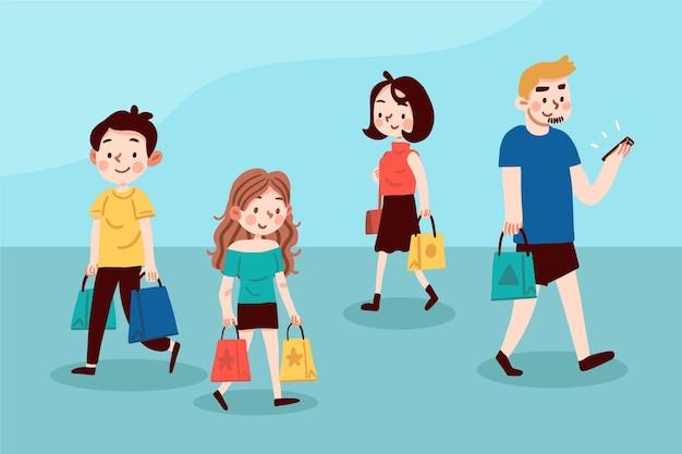 歩いて買い物袋を持つ人々