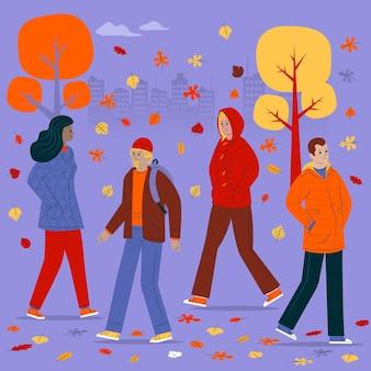 La gente che cammina in autunno all'aperto
