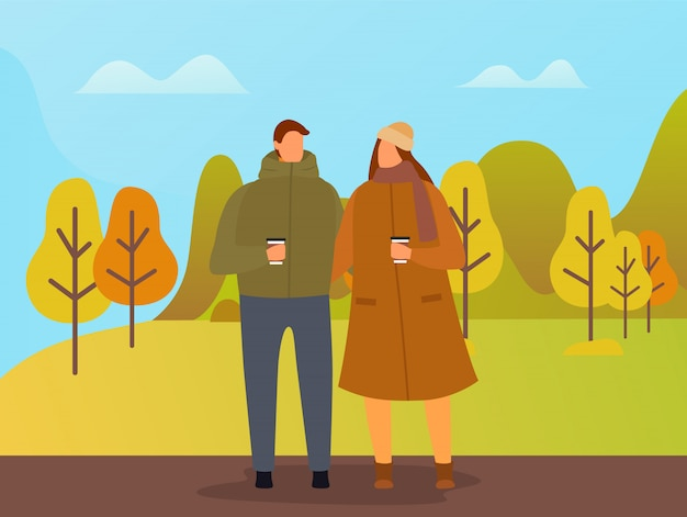 People walking in autumn park, couple on date