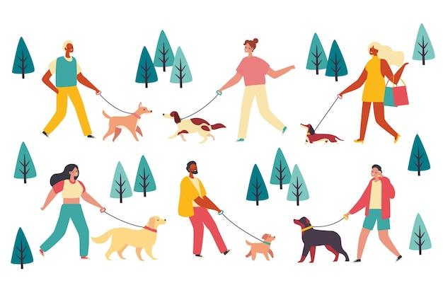 Persone che camminano nella collezione del cane