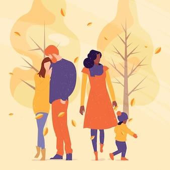 秋の公園で歩く人