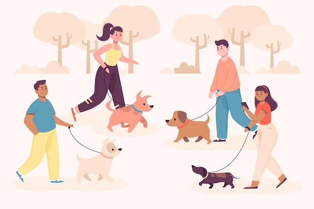 그들의 강아지와 함께 공원에서 걷는 사람들