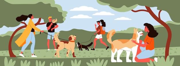 공원에서 개를 산책시키는 사람들