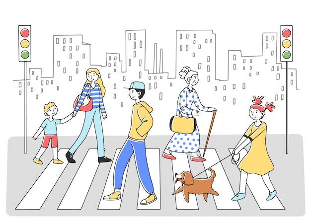 横断歩道を通って別の側に歩く人々
