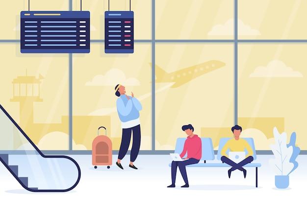 空港で手荷物を持って歩く人々