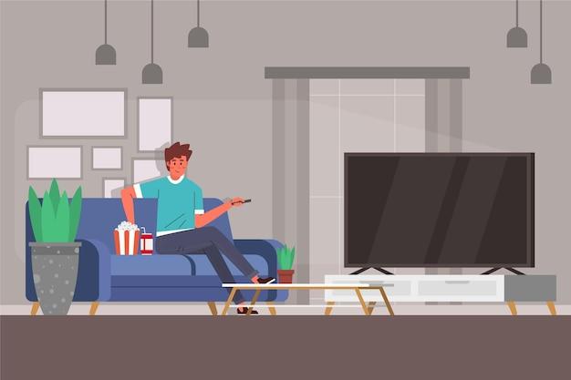 家でテレビで映画を見ている人