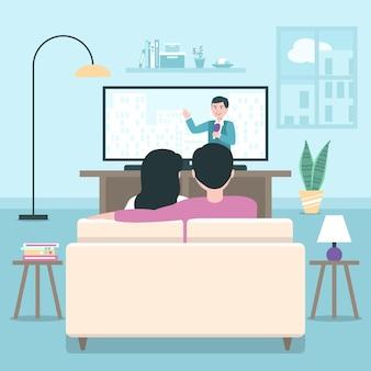 家で映画を見ている人