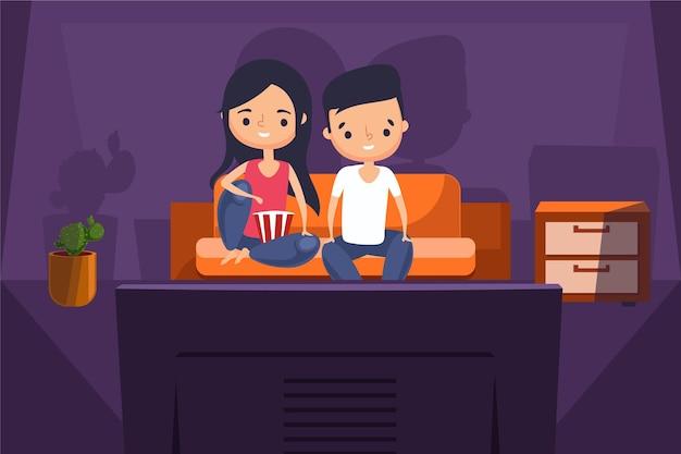Persone che guardano un film a casa in tv