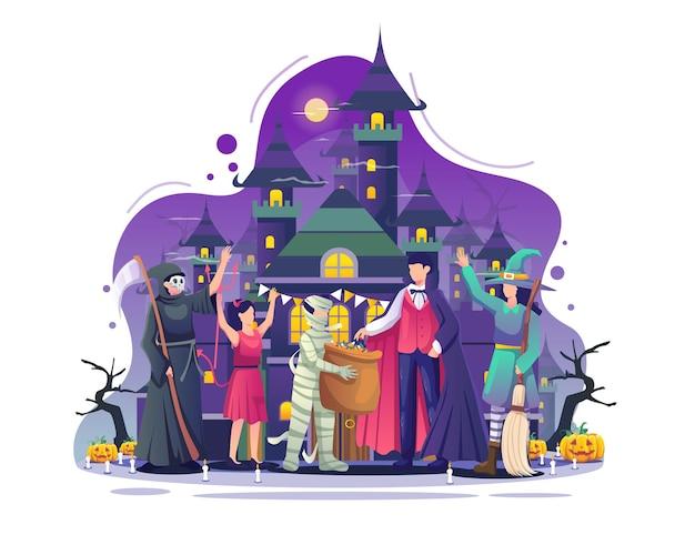 衣装を着た人々が不気味な城のイラストの前でハロウィーンの夜を祝う