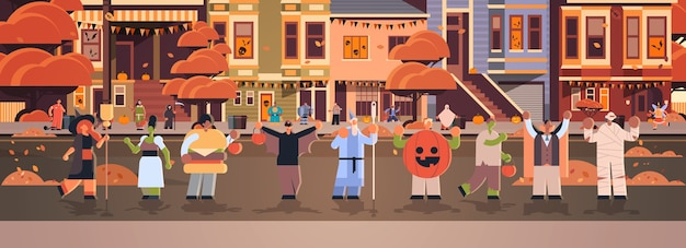 People wearing different monsters costumes walking in town tricks and treat happy halloween party celebration concept city street buildings cityscape