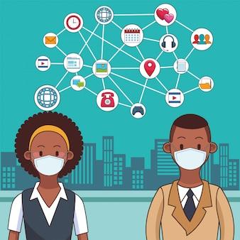 Люди, носящие медицинскую маску и технологии, чтобы оставаться на связи