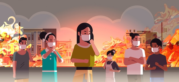 People wearing protective masks dangerous wildfire on city street with burning busidings fire development global warming natural disaster concept intense orange flames cityscape horizontal