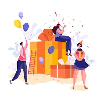 Люди с подарком отмечают праздник. новогоднее поздравление. концепция дня рождения.