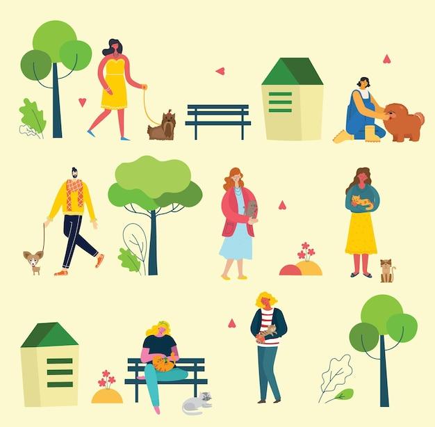 Люди с милыми домашними животными в парке