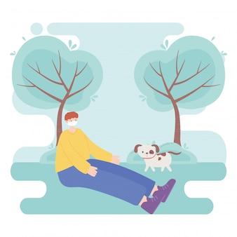 의료 얼굴 마스크를 가진 사람들, 소년 공원에서 강아지와 함께 앉아