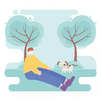 People with medical face mask, boy sitting with dog in the park
