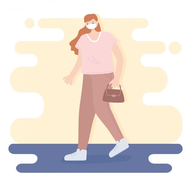 People with medical face mask, woman walking with handbag, city activity during coronavirus
