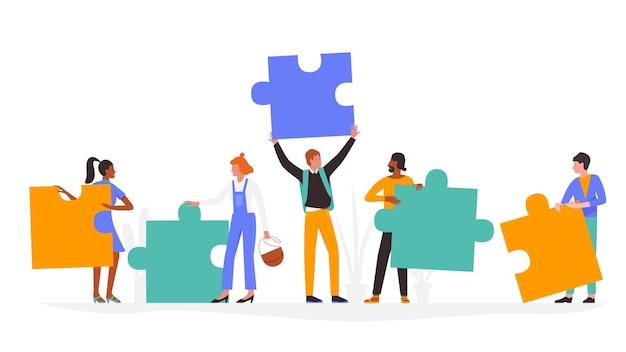 パズルの概念を持つ人々、パズルのジグソーパズルのピースを持って、一緒に立っている男性