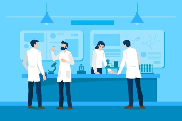 科学実験室の概念で働く人々