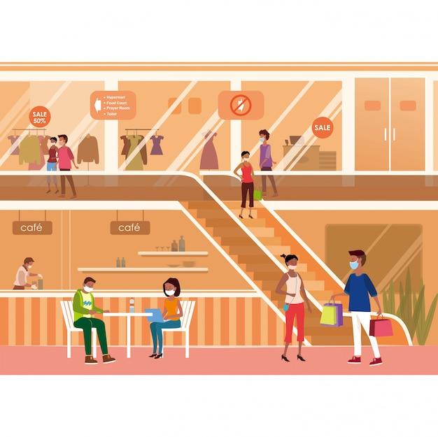 Люди в медицинских масках и наслаждаются временем в торговом центре