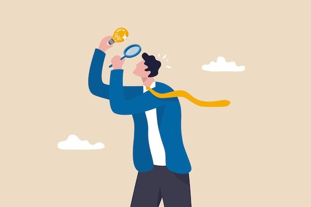 完璧主義者、細部への過度の注意、高水準の目標、完璧な結果の概念に焦点を当て、虫眼鏡で電球のアイデアの細部をすべて見ている完璧主義のビジネスマン。