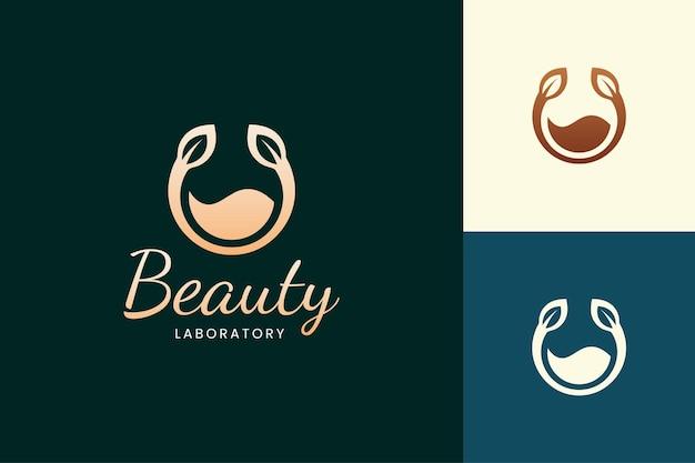 Логотип парфюмерного спрея золотого цвета для косметического бренда