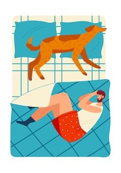 人のベッドの犬は一緒に眠る動物の若い幸せなキップ眠り