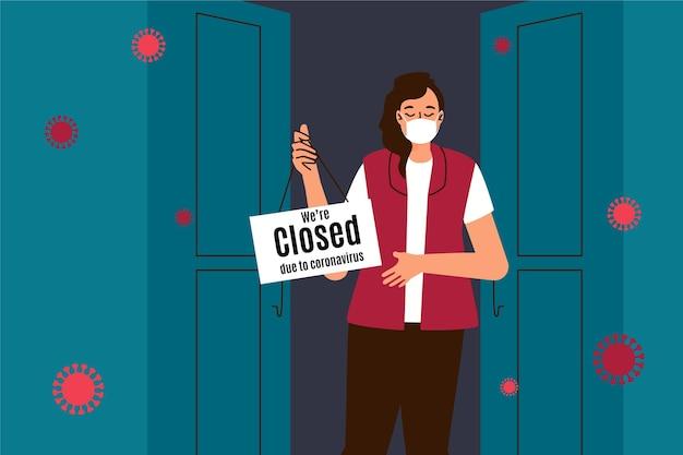 Persona che appende un cartello chiuso