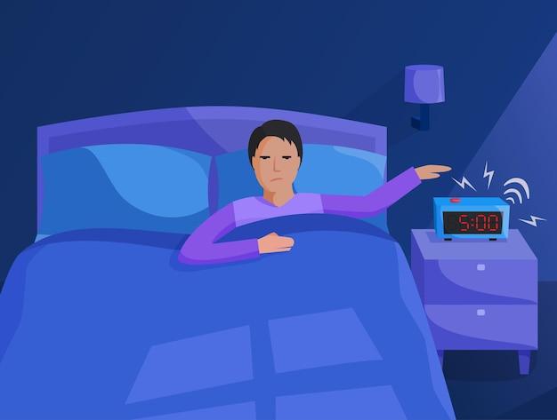이른 아침에 일어나는 침대에 있는 사람.