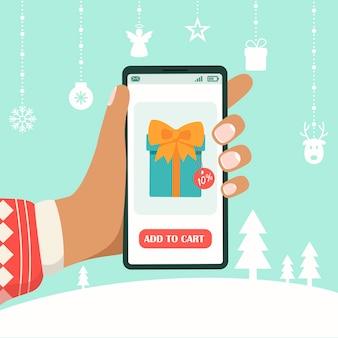 人はクリスマスの買い物にスマートフォンを使用しています。モバイルアプリでの新年とクリスマス。