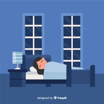 Persona che dorme sullo sfondo del letto