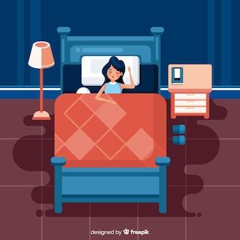 플랫 스타일의 침대에서 자고있는 사람