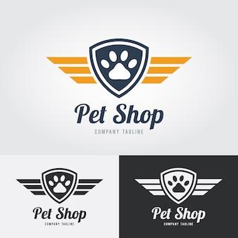 애완 동물가 게 로고 템플릿. 방패와 날개 동물 발 인쇄 아이콘입니다. 애완 동물 가게, 호텔, 수의사 클리닉 벡터.