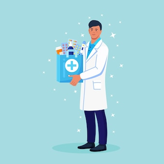 Pharmacist holds paper bag with medicines, drugs and pill bottles inside in hands. online home delivery pharmacy service. doctor in white coat with stethoscope