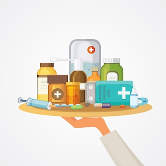 Pharmacy concept with pills capsules. doctor hand holds tray with medicaments.