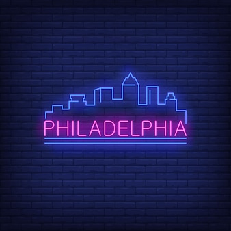Philadelphia neon lettering and city buildings silhouette. sightseeing, tourism, travel.