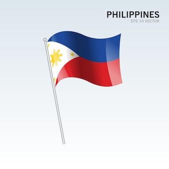 フィリピンは、灰色の背景に旗を振って Premiumベクター