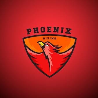 フェニックスライジングのロゴのテンプレート。シールドで飛んでいる火の鳥のイラスト。スポーツチームのエンブレム、リーグラベルなどに最適