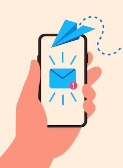 Телефон в руке с летающим бумажным самолетиком и входящие сообщения с уведомлением плоский стиль